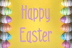 Easter eggs on yellow background. stock photography