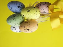 Easter eggs on yellow color background with space. Concept royalty free stock images