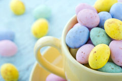 Small easter eggs in a yellow cup Royalty Free Stock Image