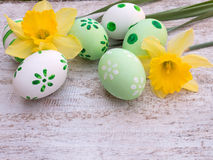 Easter eggs and yellow daffodil flowers composition Royalty Free Stock Photography