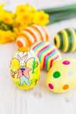 Easter eggs with yellow daffodils Royalty Free Stock Photo