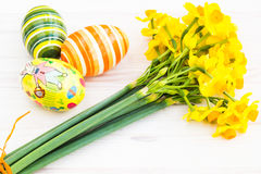 Easter eggs with yellow daffodils Royalty Free Stock Image