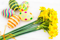 Easter eggs with yellow daffodils Royalty Free Stock Photography