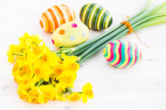 Easter eggs with yellow daffodils Stock Images