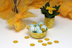 Easter eggs and yellow flowers stock image