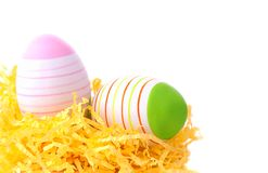Easter eggs in yellow nest Stock Photos