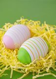 Easter eggs in yellow nest Royalty Free Stock Photo