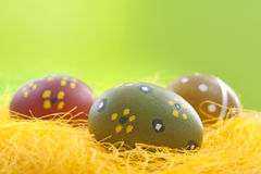 Easter eggs on the yellow straw Royalty Free Stock Image