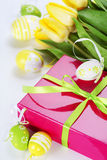 Easter eggs with yellow tulip flowers and gift box Royalty Free Stock Photography