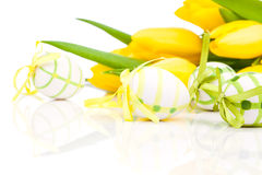 Easter eggs with yellow tulip flowers Stock Photos