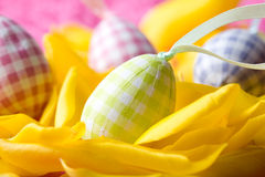 Easter eggs on yellow tulip petals Royalty Free Stock Photo