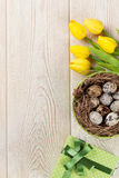 Easter with eggs and yellow tulips Stock Photography