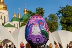 Easter exhibition. Kyiv, Ukraine, Sophia Square, 2 of May 2016. Easter exhibition. Close up shot of the amazing Easter egg with image of an angel on the violet stock photography