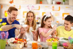 Easter family coloring eggs royalty free stock photography