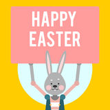 Easter feliz Coelho dos desenhos animados com sinais em um fundo amarelo Fotografia de Stock