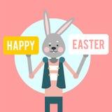 Easter feliz Coelho dos desenhos animados com sinais em um fundo cor-de-rosa Imagens de Stock