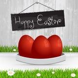 Easter feliz Ovos de Easter vermelhos A grama com uma cerca de madeira e Fotos de Stock