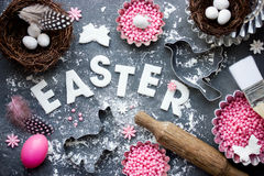 Easter festive baking background with Easter egg, bird nest, can Stock Images