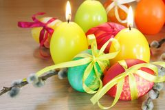 Easter Festive Painted Eggs and Candles Royalty Free Stock Photo