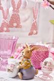 Easter table decoration with clay bunny figurine Stock Images