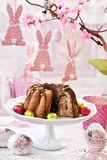 Easter festive table with marble ring cake Stock Photography