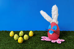 Easter field. Studio shot of an Easter field with bunny and Easter eggs Stock Photo