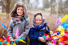 Easter in Finland. Kids outdoors dressed for Easter traditional celebration in Finland Royalty Free Stock Photography