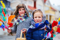 Easter in Finland. Kids outdoors dressed for Easter traditional celebration in Finland Royalty Free Stock Photo
