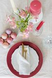 Easter flat lay serving plate with gold tableware and eggs stock photography
