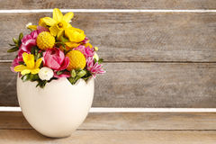 Easter floral arrangement in white egg shell Royalty Free Stock Photos