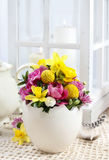 Easter floral arrangement in white egg shell Stock Photography