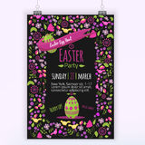 Easter floral invitation with colorful eggs on dark background. Can be used for easter greetings, easter icons, banners. Stock Photography
