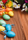 Easter flower arrangement and colorful eggs Stock Images