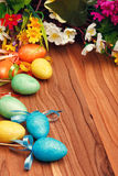 Easter flower arrangement and colorful eggs Royalty Free Stock Photos