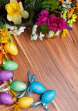 Easter flower arrangement and colorful eggs on Royalty Free Stock Photography