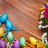 Easter flower arrangement and colorful eggs on Stock Photo