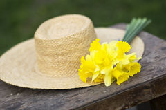 Easter flower and straw hat Royalty Free Stock Photos