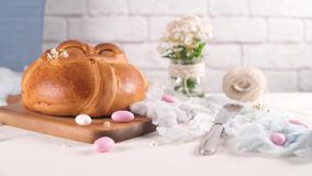 Easter folar with egg. On wooden table top stock footage