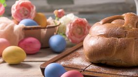 Easter folar with egg. On wooden table top