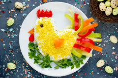 Easter food - traditional Easter salad shaped hen. Decorated with egg yolk, color pepper and parsley royalty free stock photo