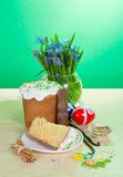 Easter food and vase with the flowers on table Stock Photo