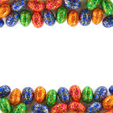 Easter Frame. Frame composition of many Easter chocolate eggs isolated in white Royalty Free Stock Photography