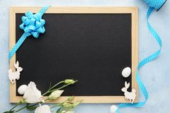 Easter frame background with chalkboard, flowers and bunny stock image