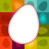 Easter frame on checked background. Easter greeting with lacy egg-shaped label and checked background Stock Photos