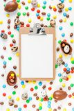 Easter frame with chocolate eggs, colorful candies. Creative Top view flat lay holiday composition Easter quail, chocolate eggs, colorful candies on white wooden stock photos