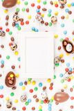 Easter frame with chocolate eggs, colorful candies. Creative Top view flat lay holiday composition Easter quail, chocolate eggs, colorful candies on white wooden stock image