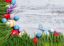 Easter frame. With eggs and grass royalty free stock photo