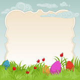 Easter frame with painted eggs. Easter card featuring colorful painted eggs on a beautiful flowery meadow with copyspace for your text Royalty Free Stock Photography