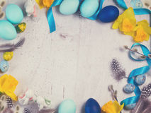 Easter frame with painted eggs and flowers Royalty Free Stock Image