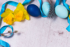 Easter frame with painted eggs and flowers Stock Images
